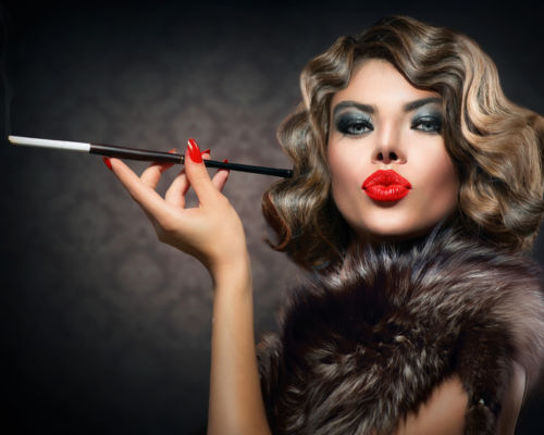Beauty Retro Woman with Mouthpiece. Vintage Styled Beauty